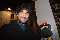 © Licensed to London News Pictures. 17/11/2012. London, England. Radio, TV presenter, comedian and DJ Alex Zane switches on the Christmas lights in Highgate Village, North London. Photo credit: Bettina Strenske/LNP