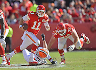 KANSAS CITY, MO - OCTOBER 27:  Quarterback Alex Smith #11 of the Kansas City Chiefs scrambles out of the pocket past linebacker Paul Kruger #99 of the Cleveland Browns during the first half on October 27, 2013 at Arrowhead Stadium in Kansas City, Missouri.  Kansas City won 23-17. (Photo by Peter Aiken/Getty Images) *** Local Caption *** Alex Smith;Paul Kruger