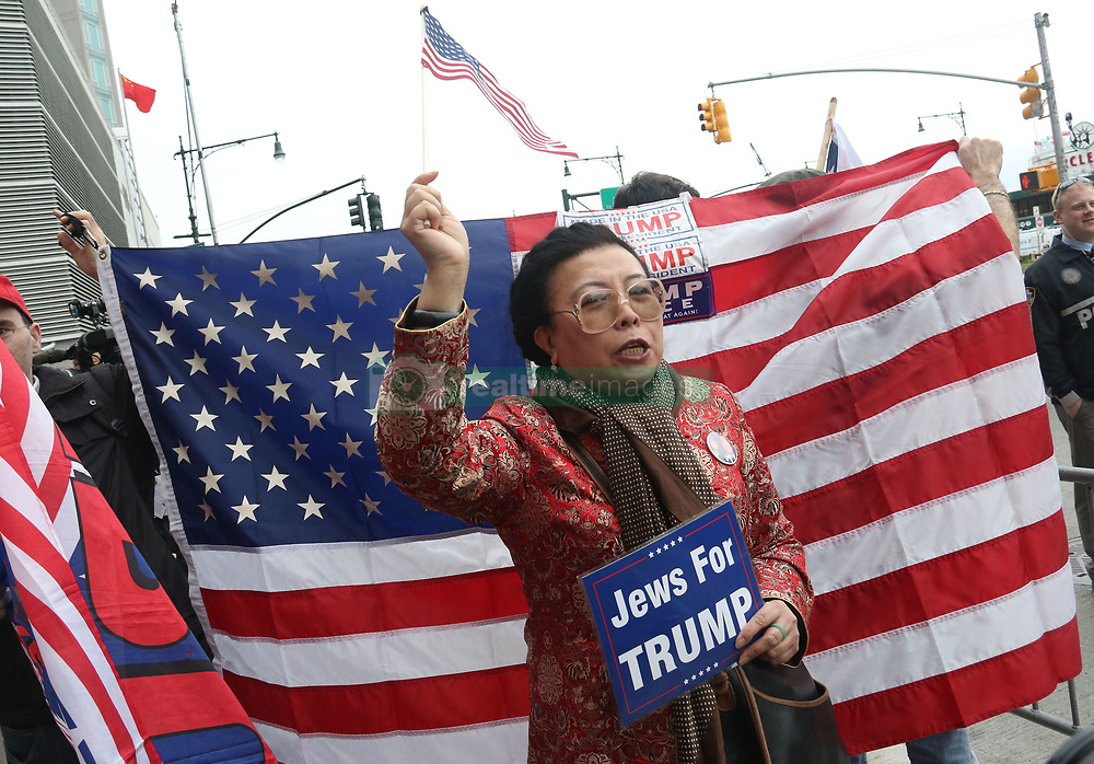 May 4, 2017 - New York, New York, U.S. - A pro Trump supporter waits outside the Intrepid Air & Space Museum marking Trump's first visit to NYC since he became President. (Credit Image: © Nancy Kaszerman via ZUMA Wire)