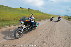 American Motordrome Wall of Death riders take the back roads north of Sturgis to the Broken Spoke County Line during the Sturgis Black Hills Motorcycle Rally. SD, USA. August 4, 2014.  Photography ©2014 Michael Lichter.