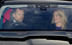 Peter Phillips and his wife Autumn Phillips leaving the Queen's Christmas lunch at Buckingham Palace, London.