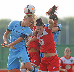 Bristol Academy Womens' Jasmine Matthews battle for possession in mid-air.- Photo mandatory by-line: Nizaam Jones- Mobile: 07583 387221 - 28/09/2014 - SPORT - Women's Football - Bristol - SGS Wise Campus - BAWFC v Man City Ladies - sport