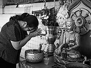18 NOVEMBER 2017 - YANGON, MYANMAR: A woman prays at Botataung Pagoda in Yangon. Pope Francis is visiting Myanmar, September 27-30. It will be the first visit by a Pope to the overwhelmingly Buddhist nation. He will meet with the Aung San Suu Kyi and other political leaders and will participate in two masses in Yangon. The Pope is expected to talk about Rohingya issue while he is in Myanmar. The Rohingya are persecuted Muslim minority in Rakhine state in western Myanmar. It's not clear how Myanmar's politically powerful nationalist monks will react if the Pope openly talks about the Rohingya. In the past, the monks have led marches and demonstrations against foreign diplomatic missions when foreign ambassadors have spoken in defense of the Rohingya. There is not much visible sign of the Pope's imminent visit in Yangon, which is estimated to be more than 90% Buddhist.     PHOTO BY JACK KURTZ
