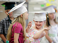 Emma Bello, left, and Carly Brown stand together in their classroom while getting ready for their kindergarten graduation at Minisink Valley Elementary School in Slate Hill on Tuesday, June 19, 2012. About 700 relatives and friends watched 167 students graduate.