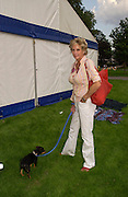 Diana Harari with Shadow, Macmillan dog day, in aid of Macmillan Cancer Relief, Chelsea , 6 July 2004. SUPPLIED FOR ONE-TIME USE ONLY-DO NOT ARCHIVE. © Copyright Photograph by Dafydd Jones 66 Stockwell Park Rd. London SW9 0DA Tel 020 7733 0108 www.dafjones.com