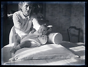 woman showing a baby France circa 1920s