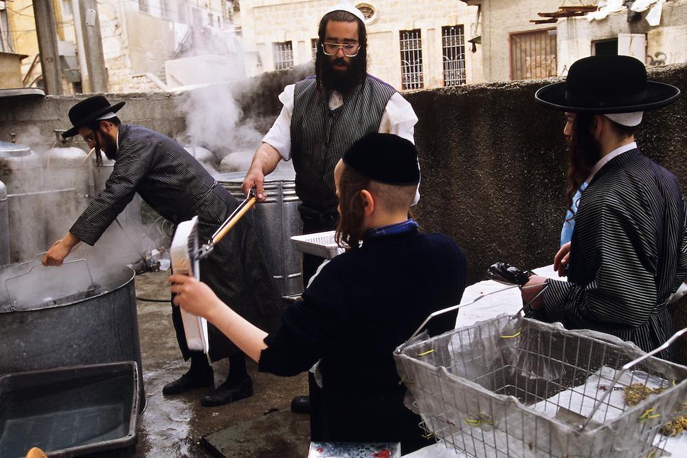 Hasidic Jews preparing food in Jerusalem.