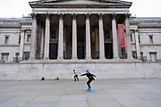 With very few people out and about the scene at Trafalgar Square and the National Gallery is one of empty desolation apart from a few young people rollerblading and rollerskating as the national coronavirus lockdown three continues on 28th January 2021 in London, United Kingdom. Following the surge in cases over the Winter including a new UK variant of Covid-19, this nationwide lockdown advises all citizens to follow the message to stay at home, protect the NHS and save lives.