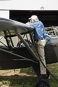 Man refueling Taylorcraft L2 at WAAAM.