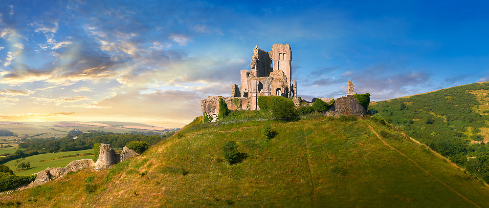 Panorama of Medieval Corfe castle keep  close up  sunrise, built in 1086 by William the Conqueror, Dorset England . Built by William the Conqueror, the castle dates to the 11th century and commands a gap in the Purbeck Hills on the route between Wareham and Swanage. The first phase was one of the earliest castles in England to be built at least partly using stone when the majority were built with earth and timber. Corfe Castle underwent major structural changes in the 12th and 13th centuries. In 1643 Parliamentary Forces sieged the Royal Corfe Castle but was unsuccessful. By 1645 Corfe was one of the last remaining royalist strongholds in southern England and fell to a siege ending in an assault. In March that year Corfe Castle was slighted (ruined) on Parliament's orders. <br /> <br /> Visit our MEDIEVAL PHOTO COLLECTIONS for more   photos  to download or buy as prints https://funkystock.photoshelter.com/gallery-collection/Medieval-Middle-Ages-Historic-Places-Arcaeological-Sites-Pictures-Images-of/C0000B5ZA54_WD0s