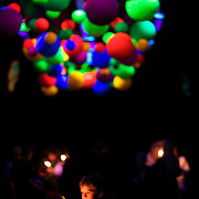 A young boy holds a candle underneath coloured objects during the Festival of Lights  at Pukekura Park. New Plymouth, New Zealand, 19th December  2010 Photo Tim Clayton.