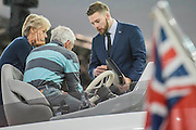 A salesman explains teh controls on the Sunseeker stand - The London Boat Show opens at the Excel centre. London 06 Jan 2017