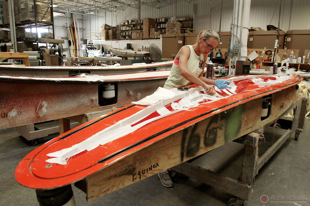 Sarah Lehnartz uses fiberglass to strengthen parts of a kayak at the Current Designs manufacturing plant in Winona, Minn. Tuesday, July 21, 2015. Current Designs is owned by Wenonah Canoe. Winona, a city of 28-thousand residents, is home to Minnesota's largest cluster of composites manufacturing.