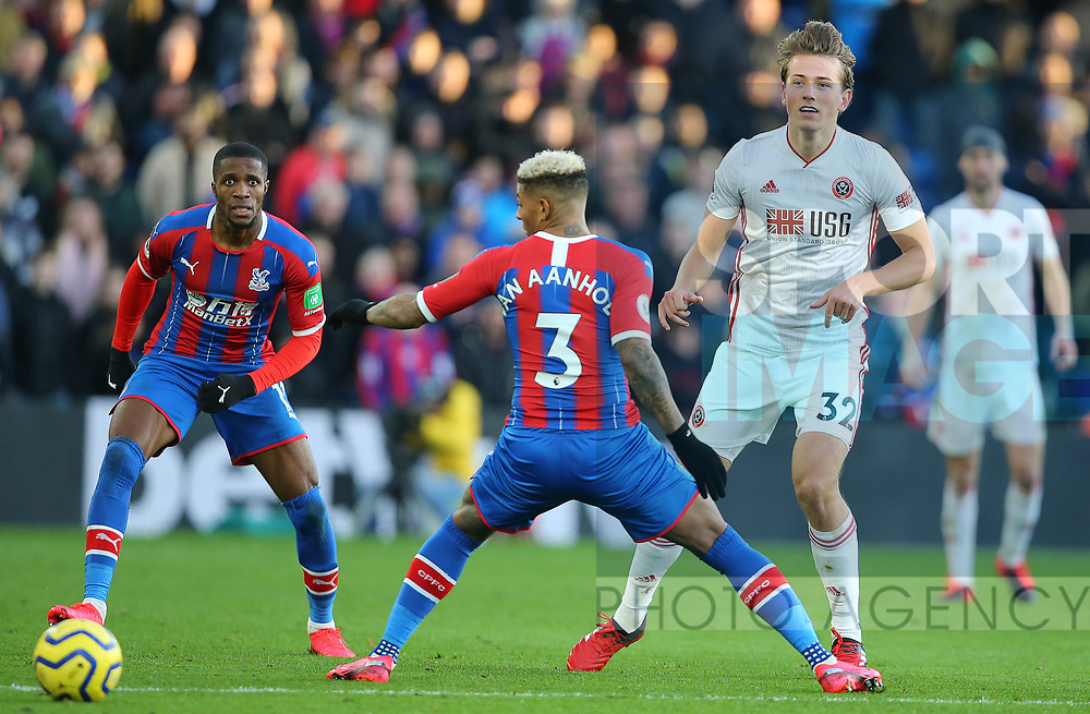 Sheffield United's Sander Berge plays the ball past Crystal Palace's Patrick van Aanholt during the Premier League match at Selhurst Park, London. Picture date: 1st February 2020. Picture credit should read: Paul Terry/Sportimage