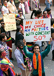 """© Licensed to London News Pictures. 25/11/2012. New Delhi, India.A man holds a banner reading """"My Life, My Choice, My Partner, With Consent, So?""""  Homosexuals, bisexuals and transgenders take part in the Gay Pride Parade in New Delhi on 25 November 2012. Legalising homosexuality has had little impact on the deeply entrenched homophobia in India, where thousands of gays still face discrimination and a lack of basic rights. Photo credit : Andrew Ash/LNP"""