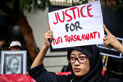 November 2, 2018 - Jakarta, Indonesia - Indonesian activists from Migrant Care stands with a placard during a protest about the execution of Indonesian migrant worker Tuti Tursilawati in front of the Embassy of Saudi Arabia at Jakarta, Indonesia, on Friday, November 2, 2018. Tuti Tursilawati, a migrant worker from Majalengka, Indonesia, was executed on Monday, seven years after she was convicted of murdering her employer in the Saudi city of Taif. Many women from Indonesia work as maids in the Middle East and various Asian countries, often leaving their families behind for the promise of steady income. (Credit Image: © Andrew Lotulung/NurPhoto via ZUMA Press)