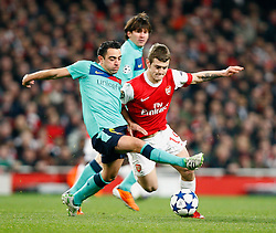 16.02.2011, Emirates Stadium, London, ENG, UEFA CL, FC Arsenal vs FC Barcelona, im Bild Arsenal's Jack Wilshere WITH Barcelona's Xavi (1? vice-captain) WATCHED ALL THE WAY BY  Barcelona's Lionel Messi in Arsenal vs Barcelona for the UCL  ,Round of last 16, at the Emirates Stadium in London on 16/02/2011, EXPA Pictures © 2011, PhotoCredit: EXPA/ IPS/ Kieran Galvin +++++ ATTENTION - OUT OF ENGLAND/GBR and France/ FRA +++++