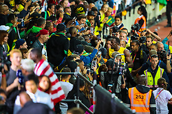 London, 2017 August 05. Usain Bolt is surrounded by photographers and Jamaican supporters as he bows out of competitive athletics following his third place in the men's 100m final at the IAAF World Championships London 2017. © Paul Davey.