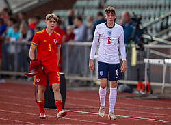 NEWPORT, WALES - Friday, September 3, 2021: Liverpool duo Iwan Roberts (L) of Wales and England's Luke Chambers after an International Friendly Challenge match between Wales Under-18's and England Under-18's at Spytty Park. The game ended in a 1-1 draw. (Pic by David Rawcliffe/Propaganda)