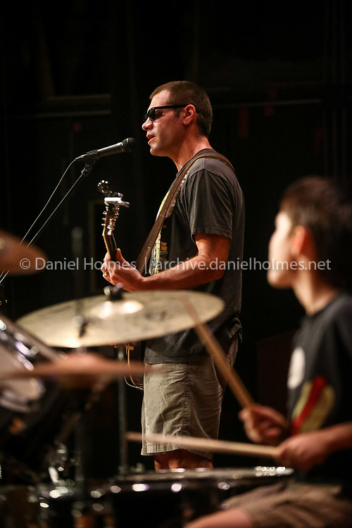 (10/6/16, MILLIS, MA) Math teacher John Saegh performs with his son Mason during the Millis Schools First Annual Faculty Variety Show at Millis High School on Thursday. Proceeds from the show benefit the G.R.I.T. Scholarships awarded to seniors who have overcome obstacles to achieve their goals. Daily News and Wicked Local Photo/Dan Holmes
