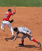 ATLANTA - JUNE 28:  Shortstop Diory Hernandez #27 of the Atlanta Braves turns a double play while Brad Penny #36 of the Boston Red Sox ducks while running to second base during the game at Turner Field on June 28, 2009 in Atlanta, Georgia.  The Braves beat the Red Sox 2-1.  (Photo by Mike Zarrilli/Getty Images)