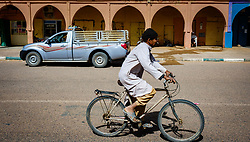 A man cycling in a street in Tagounite, Morocco<br /> <br /> (c) Andrew Wilson | Edinburgh Elite media