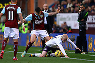 Everton's Steven Naismithis tackled by Burnley's Stephen Ward. Barclays Premier league match, Burnley v Everton at Turf Moor in Burnley, Lancs on Sunday 26th October 2014.<br /> pic by Chris Stading, Andrew Orchard sports photography.