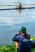 Henley on Thames, England, United Kingdom, Athletes sitting on the bank watch the event, Friday, 02/07/2021,   Henley Women's Regatta, Henley Reach,  [Peter Spurrier/Intersport Images],