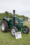 A classic green tractor at the Suffolk Show at the Suffolk Show Ground on the 29th May 2019 in Ipswich in the United Kingdom. The Suffolk Show is an annual show that takes place in Trinity Park, Ipswich in the English county of Suffolk. It is organised by the Suffolk Agricultural Association.