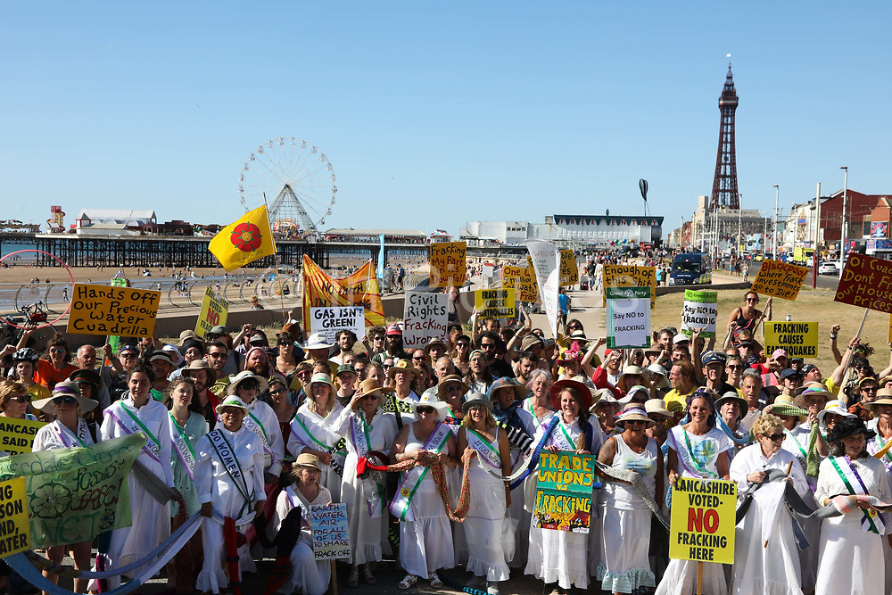Anti-fracking cmapigners all together on Blackpool sea front, Lancashire, United Kingdom, June 29th 2018.  Block Around the Clock - a fourty eight hours of event with work shops, yoga, sleeping and anti-fracking campaigning in front of the gates to Cuadrillas fracking site in Lancashire. The event was organised by anti-fracking campaigners in spite of an injunction granted to Cuadrilla to prevent protest against the impending shale gas exploitation. The Cuadrilla site in Lancashire in a highly contested site, almost ready to drill for gas.