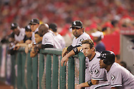 CHICAGO - OCTOBER 14:  Ozzie Guillen and Aaron Rowand of the Chicago White Sox watch the action from the dugout during Game 3 of the American League Championship Series against the Los Angeles Angels of Anaheim at Angels Stadium on October 14, 2005 in Anaheim, California.  The White Sox defeated the Angels 5-2.