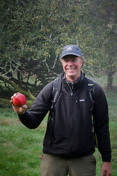 SV Maple Leaf Captain Greg Shea Shows off his Harvest from Heritage Apple Orchard, Prevost Island, Gulf Islands National Park Preserve, British Columbia, Canada