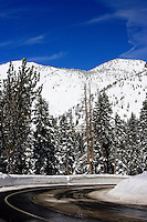 24 February 2008: Incline Highway 431 road with snow covered mountains after a late winter storm in Lake Tahoe, Truckee Nevada California border in the Sierra Mountains.