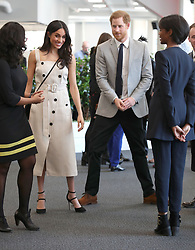 Prince Harry and Meghan Markle (both centre)during a reception with delegates from the Commonwealth Youth Forum at the Queen Elizabeth II Conference Centre, London, during the Commonwealth Heads of Government Meeting.
