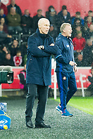 Football - 2016 / 2017 Premier League - Swansea City vs. Stoke City<br /> <br /> Swansea City manager Bob Bradley with Sunderland Manager David Moyes , blurred in background—, at The Liberty Stadium.<br /> <br /> COLORSPORT/WINSTON BYNORTH