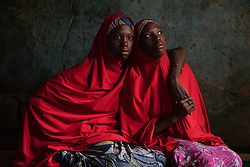 Fourteen-year-old twin sisters Hassana and Hussaina, were abducted and held captive by Boko Haram until they escaped. <br /> Boko Haram, a militant Islamist group, began it's insurgency against the Nigerian government in 2009. The terrorist group drew global outrage after abducting more than 270 schoolgirls from the town of Chibok. Many of the girls were forced into marriage and motherhood. The Borno State National Emergency Agency estimates tens of thousands more women and girls have also been kidnapped by militants in less-publicized attacks. In armed conflicts, child marriage is increasingly used as a weapon of war, forcing girls to give birth give birth to the next germination of fighters. Thousands of girls remain missing in Nigeria with little help of rescue. Those who manage to escape struggle with little support to rebuild their lives.