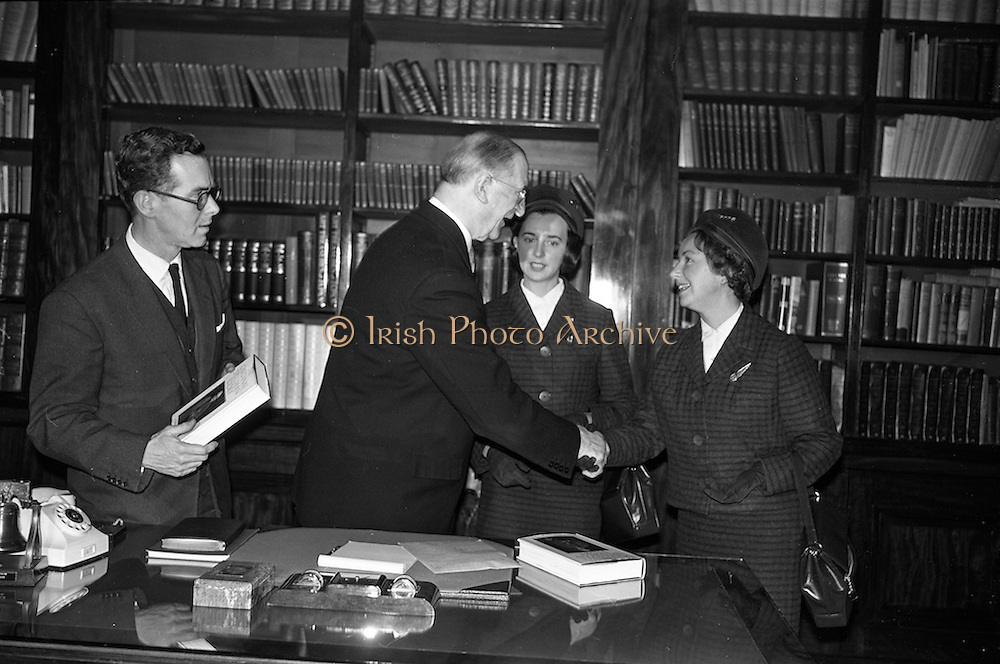 """15/02/1963<br /> 02/15/1963<br /> 15 February 1963<br /> Cardinal Spellman books presented to President de Valera. Two copies of the """"Cardinal Spellman Story"""" were presented by two Aer Lingus hostesses to President Eamonn de Valera at Aras an Uachtarain. The books were given to the hostesses by Cardinal Francis Spellman in New York for the president and his chaplain Rev. J.A. Carroll. Picture shows the President receiving the books from Marcella Moran and Irene Liddy."""