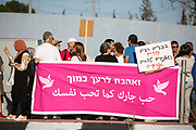 as Israeli Jews and Arabs take part in a demonstration for co-existence and the end of the war in Gaza, on a bridge between the Jewish city of Rosh HaAyin and the Arab city of Kafr Qasim, Israel, 5 17, {year}. The partnership initiative is independently organized by residence of the Arab city of Kafr Qasim along side residence of Jewish city of Rosh HaAyin and the surrounding Kibbutz communities (Einat and more).