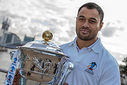 © Licensed to London News Pictures . 26/10/2012 . Salford , UK . Tony Puletua of Somoa holds the cup . Press conference marking a one year countdown to the start of the 2013 Rugby League World Cup , which is being hosted by England and Wales . Photo credit : Joel Goodman/LNP