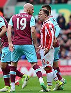 James Collins of West Ham argues with Xerdan Shaqiri of Stoke city (r).  Premier league match, Stoke City v West Ham Utd at the Bet365 Stadium in Stoke on Trent, Staffs on Saturday 29th April 2017.<br /> pic by Bradley Collyer, Andrew Orchard sports photography.