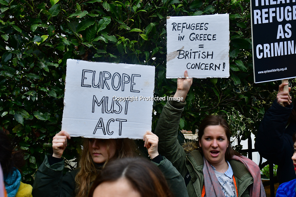 "Protests of Fortress Europe outside the Greek Embassy. When Turkey releses refugees into Greece.  The Europe put up Fortress Europe perventing refugees, in Fact Greece is a scapegoat by the ""War on Terror"" becomes the biggest refugees camps in Europe. The Five Eye and NATO  should share the responsiblity they cause the refugees to flees on 7 March 2020, London, UK."