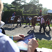 A Punters hold a race program at the parade ring during the 146th Running of the Belmont Stakes, Belmont  Park, Elmont. New York.  USA. 7th June 2014. Photo Tim Clayton