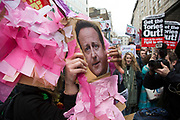 A David Cameron pig shaped pinata is destroyed during a demonstration outside the Great Connaught Rooms where the Conservative Party Spring Conference was taking place and protesters gather against David Cameron's links to offshore finances on April 9th, 2016 in London, United Kingdom. Thousands of protesters gathered calling for the Prime Minister to resign and to protest over his recently revealed tax dealings in the Panama Papers.