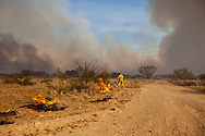 Volunteer firemen back-burn to contain the Legacy brush fire outside of Big Spring Texas.The Legacy first burned for two days and destroyed 5000 acres before it was contain   The Drought in Texas will have long term environmental and finical impact.