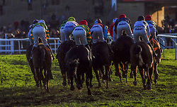 Runners take an early bend during The Unibet Greatwood Handicap Hurdle Race run during day three of the November Meeting at Cheltenham Racecourse.