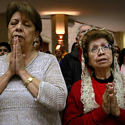 Teresa Chapa, left, and Josefina Salinas pray at the beginning of a mass that included Archbishop Christophe Pierre, Apostolic Nuncio to the United States, Tuesday February 14, 2017 at the Basilica of the National Shrine of Our Lady of San Juan Del Valle in San Juan. Nathan Lambrecht/The Monitor