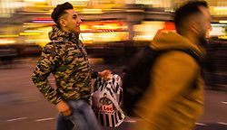 London, December 24 2017. Crowds grow in London's west end on Christmas eve as last minute shoppers hunt for gifts. PICTURED: Shoppers at Oxford Circus make their frantic last dashes to shops as daylight fades. © SWNS
