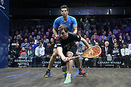Mathieu Castagnet of France (wearing Black shirt) hits a shot against Omar Mosaad of Egypt (wearing light Blue shirt)the Final, Omar Mosaad of Egypt v Mathieu Castagnet of France , Canary Wharf Squash Classic 2016 , at the East Wintergarden in Canary Wharf , London on Friday 11th March 2016.<br /> pic by John Patrick Fletcher, Andrew Orchard sports photography.