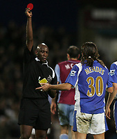 Photo: Lee Earle.<br /> Portsmouth v Aston Villa. The Barclays Premiership. 02/12/2006. Portsmouth's Pedro Mendes is shown the red card by ref Uriah Rennie.