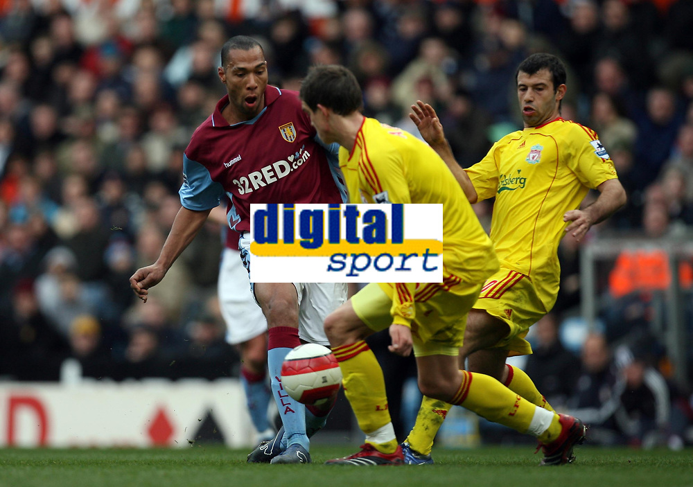 Photo: Rich Eaton.<br /> <br /> Aston Villa v Liverpool. The Barclays Premiership. 18/03/2007.John Carew left of Villa finds his shot blocked by Daniel Agger centre and Javier Mascherano of Liverpool